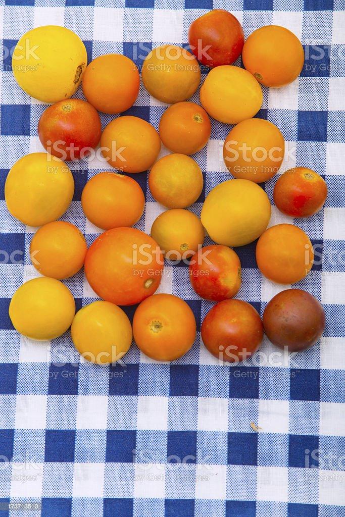 Cherry Tomatos on Picnic Table royalty-free stock photo