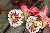 Cherry vanilla ice-cream with caramel topping. Closeup