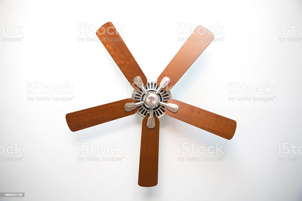 Cherry Wood and Brushed Metal Ceiling Fan stock photo