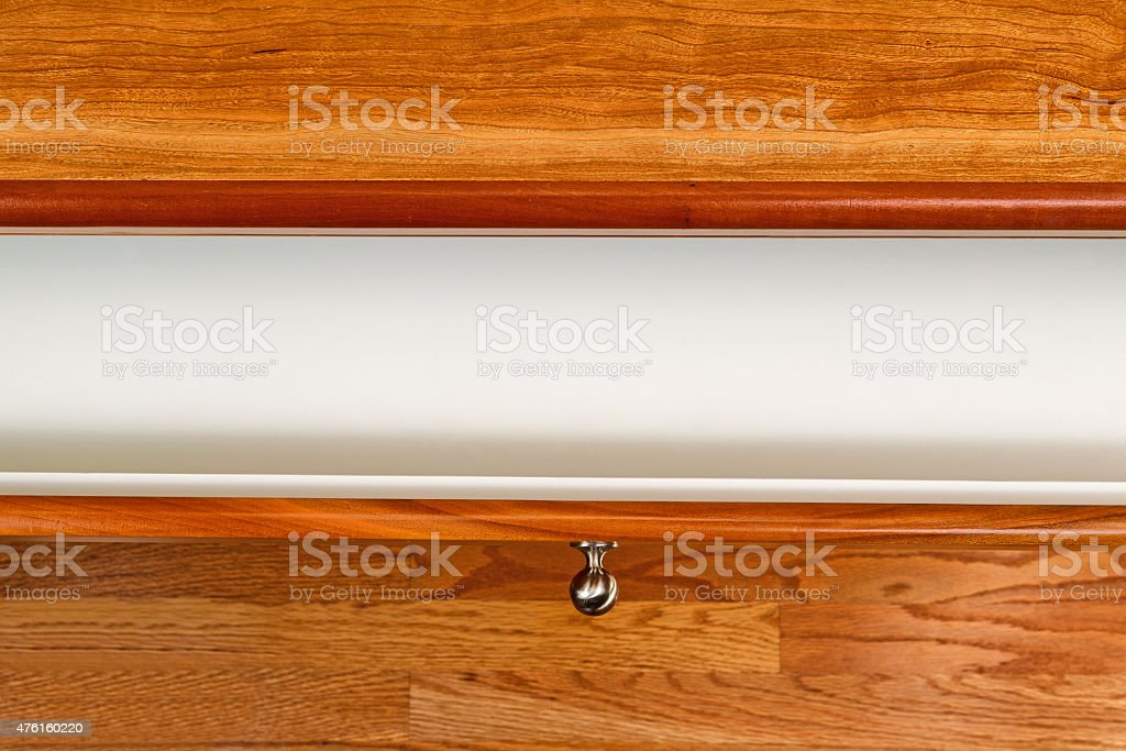 Cherry wood desktop with open drawer stock photo
