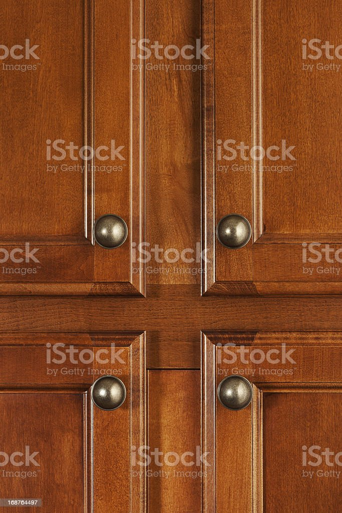 Cherry Wood Kitchen Cabinet Doors with Handles stock photo