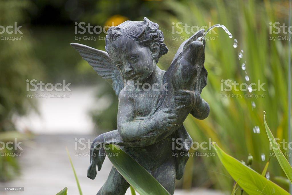 Cherub Fountain, Bronze Statue With A Fish stock photo