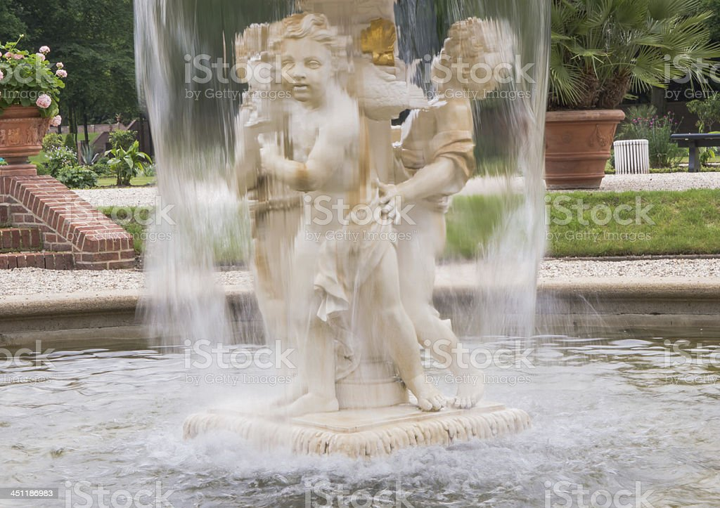 Cherub fountain with blurred water flowing royalty-free stock photo
