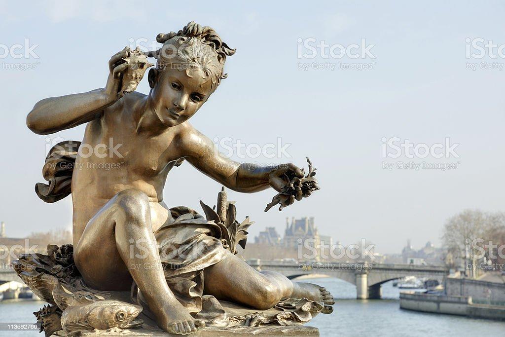 Cherub on Pont Alexandre III bridge in Paris stock photo