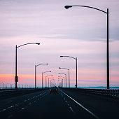 Chesapeake bridge traffic at sunset time.