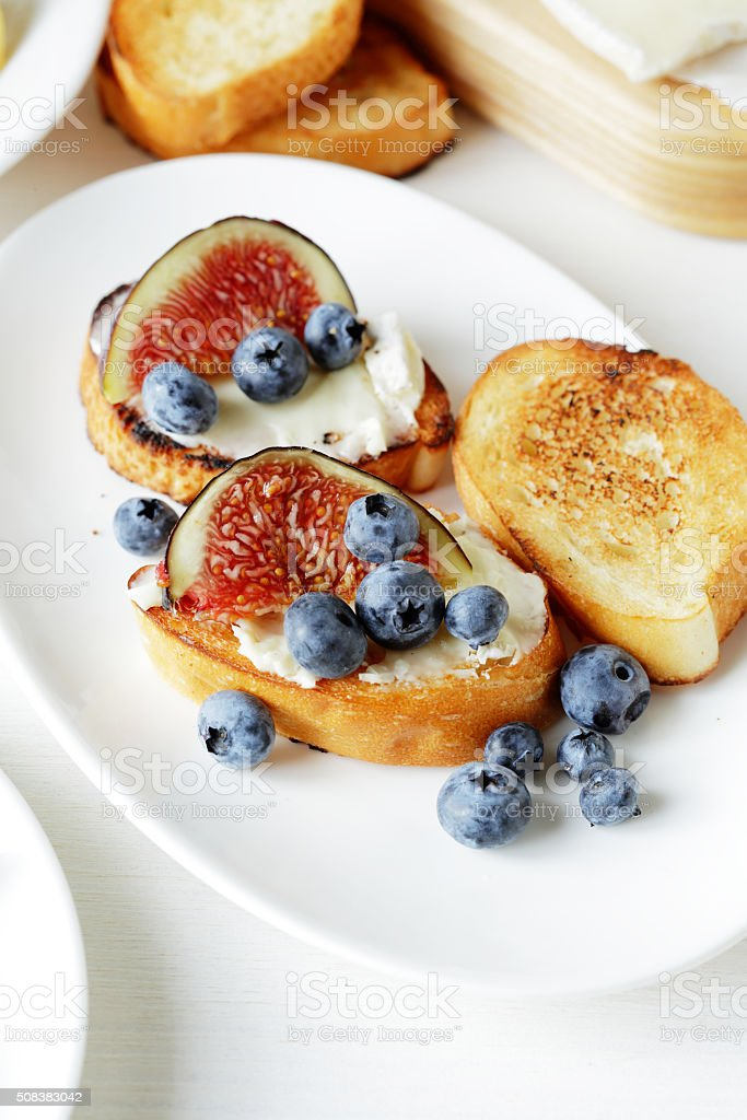 cheses with beries and fruits stock photo