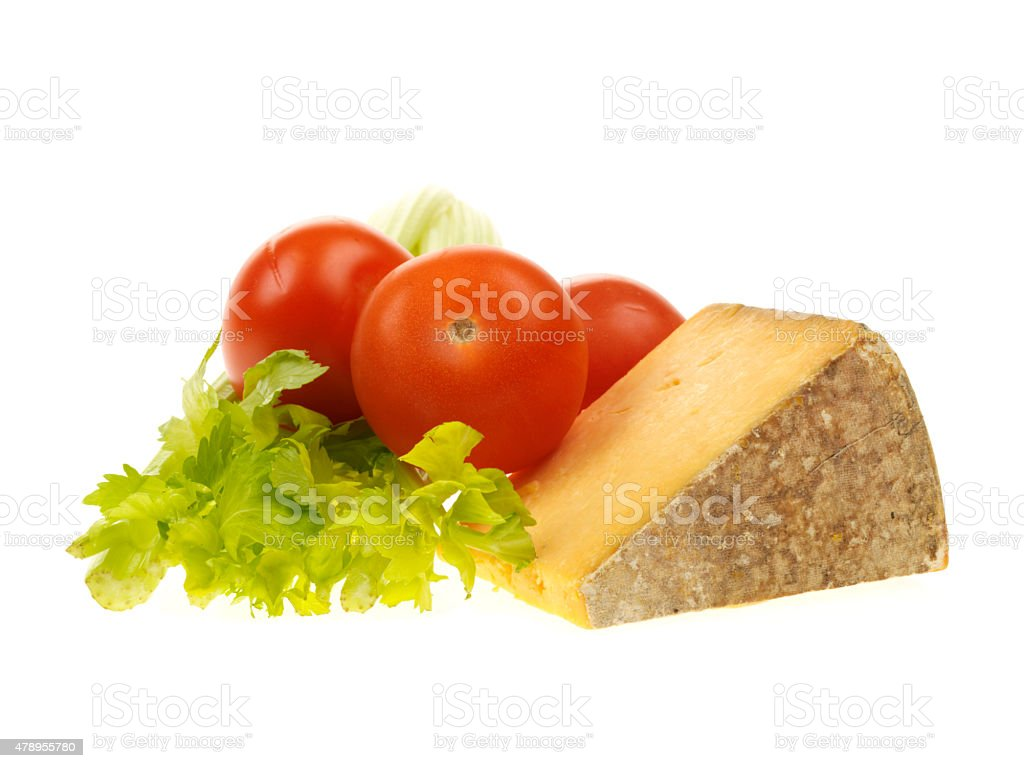 Cheshire Cheese with Celery and Tomatoes stock photo