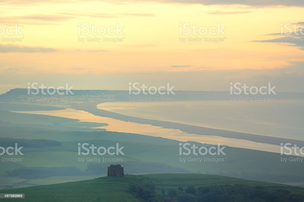 Chesil Beach and chapel stock photo