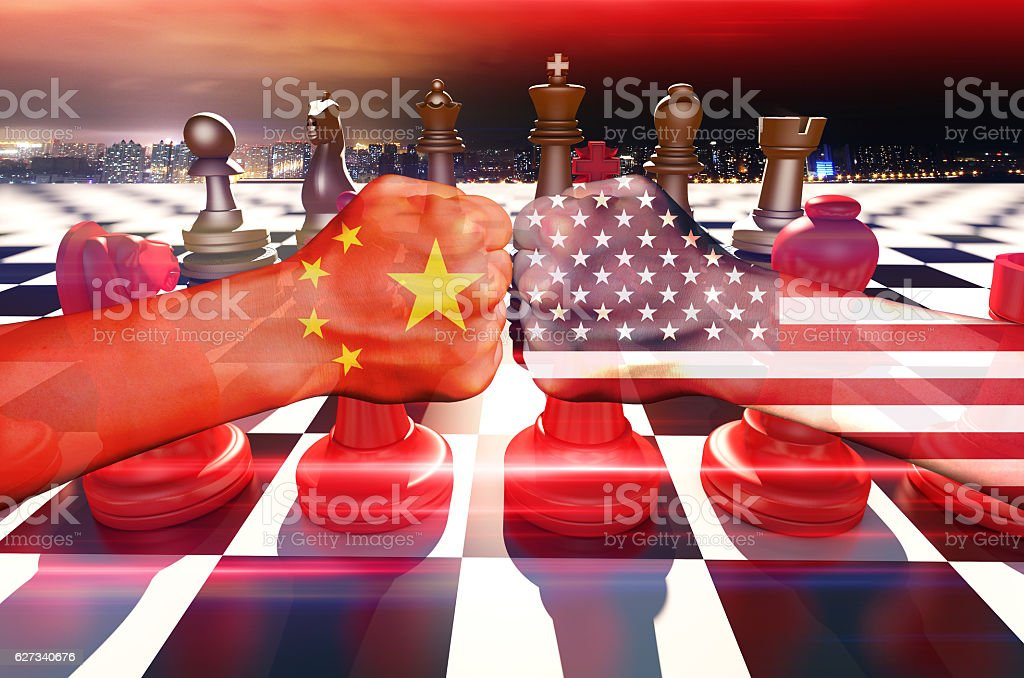 Chess and fists, China and the United States stock photo