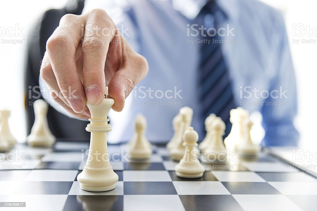 Chess and hand stock photo
