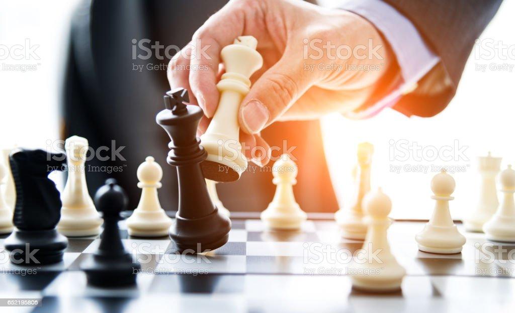 Chess and hand stock photo