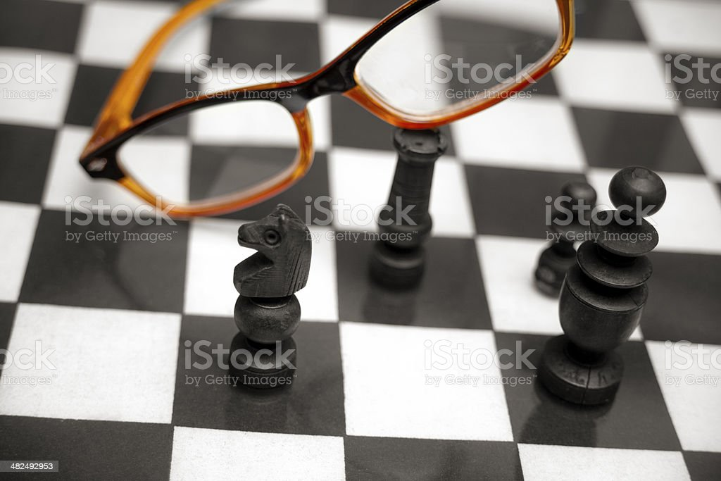Chess and orange glasses stock photo