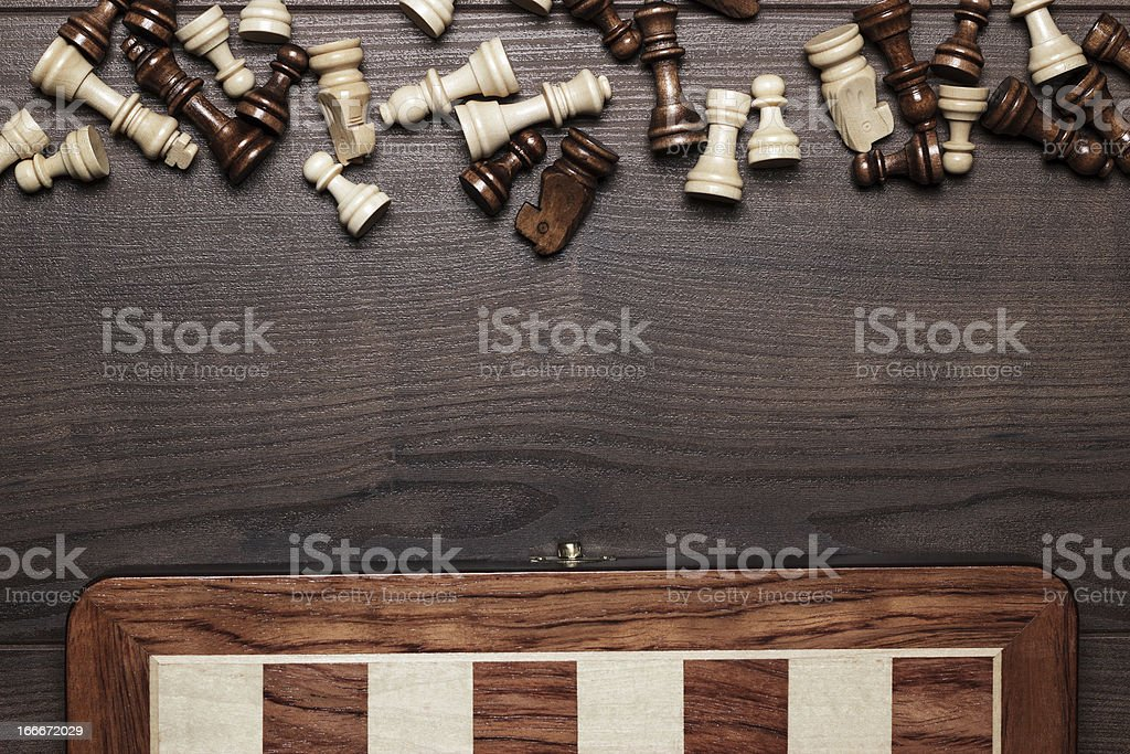 chess board and figures on woden background royalty-free stock photo
