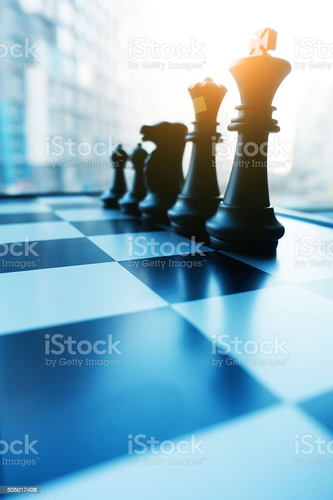 Chess board and pieces in a chess game stock photo