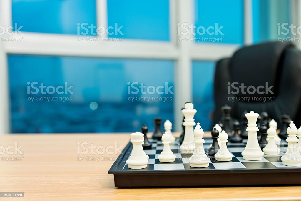 Chess board in office room stock photo