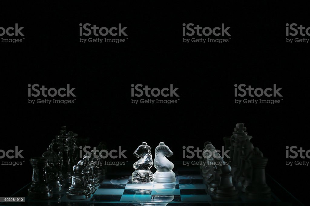 Chess board with two horses in the center stock photo