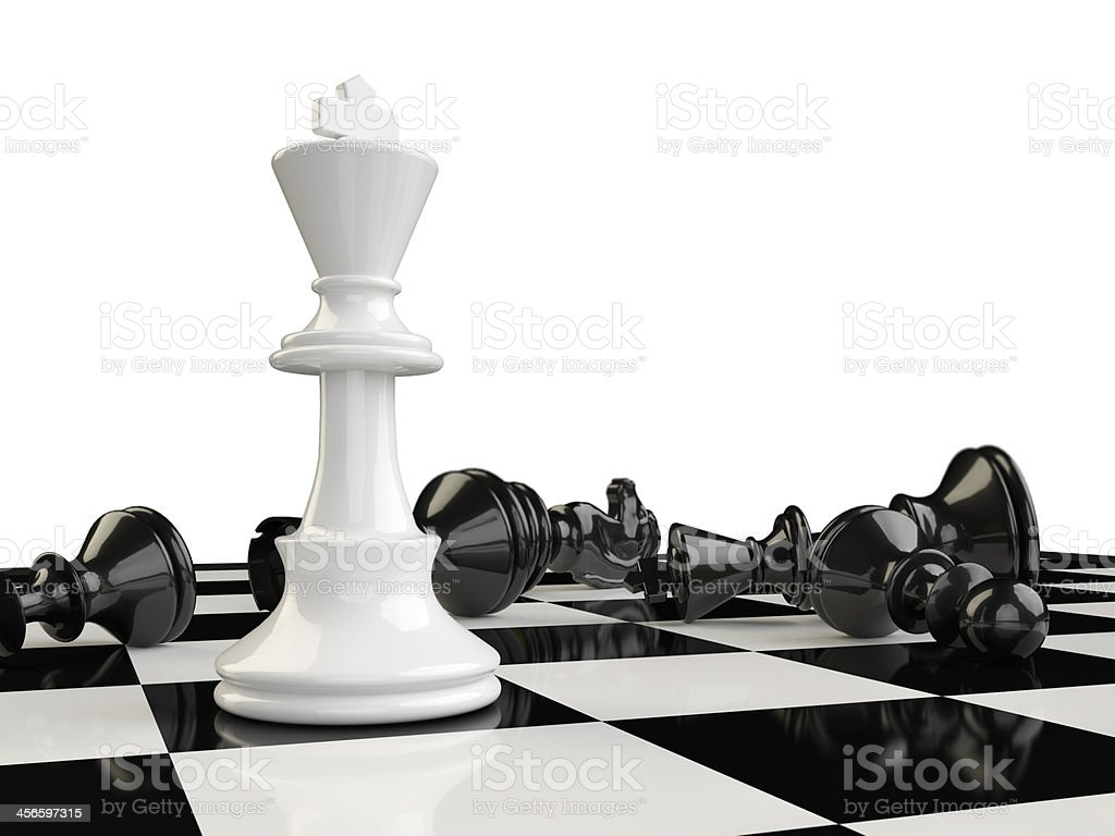 Chess board with white King standing and other pieces fallen stock photo