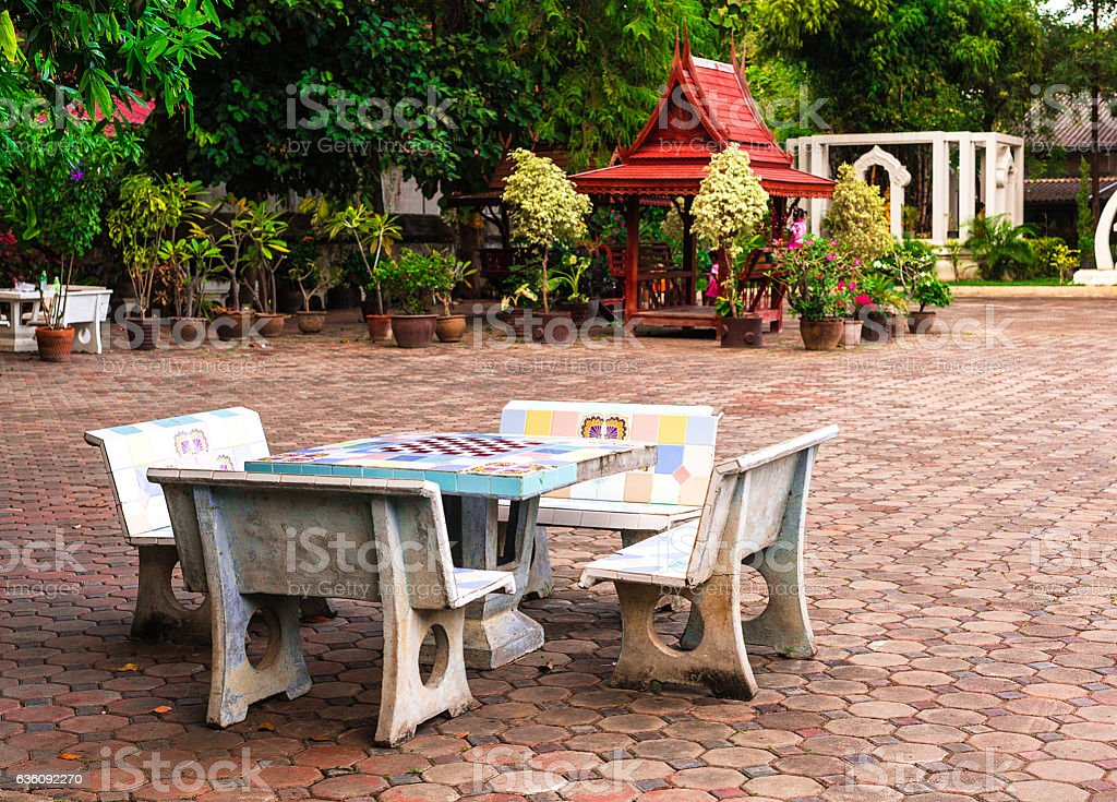 Chess, checker-board table and benches in public park stock photo