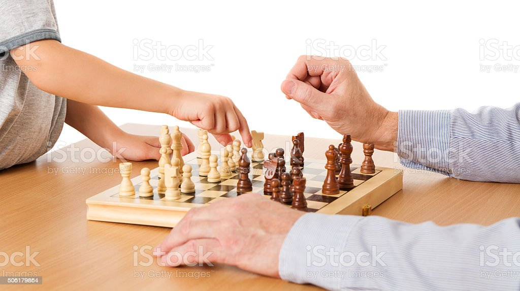 Chess, Child Senior Hands Playing, Kid Moving Pawn, Man Thinking stock photo