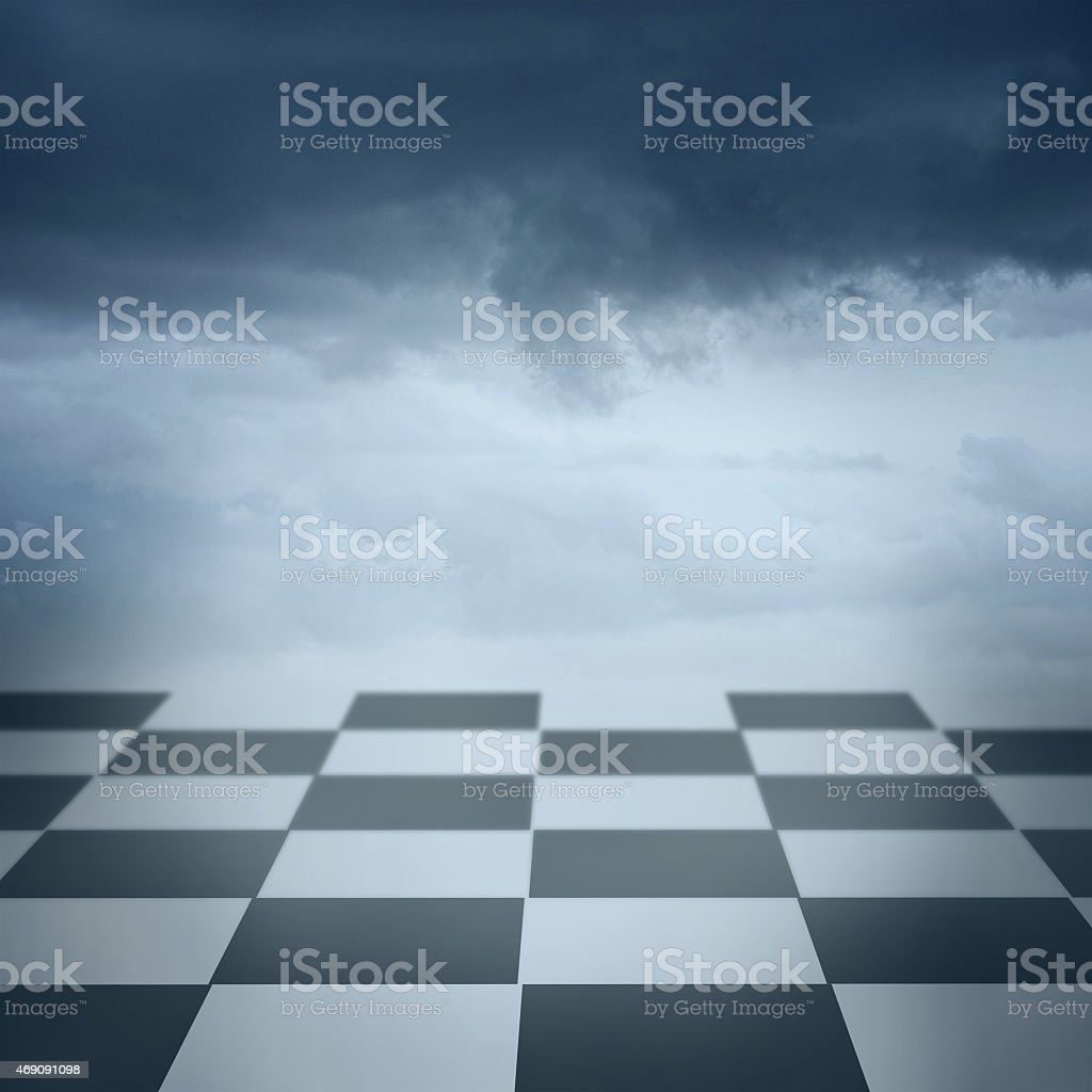 Chess floor and dramatic overcast sky premade background stock photo