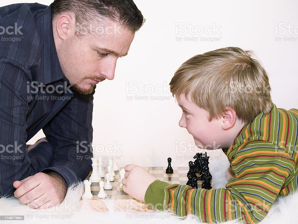 Chess game, adult  vs. child royalty-free stock photo