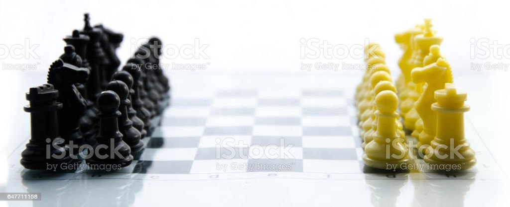 Chess game. white against black chess pieces on the board are in two rows stock photo