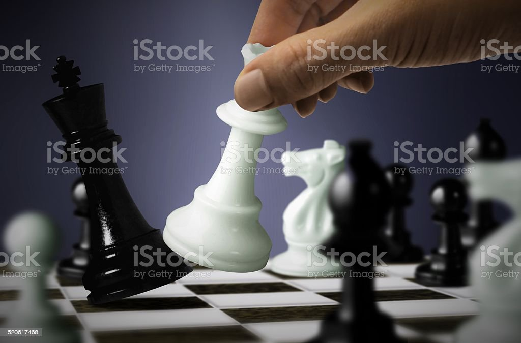 Chess game with King checkmate by Queen stock photo