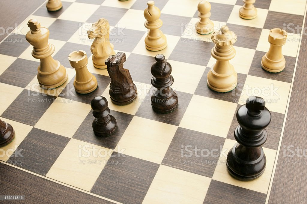 Chess game with king in checkmate position stock photo