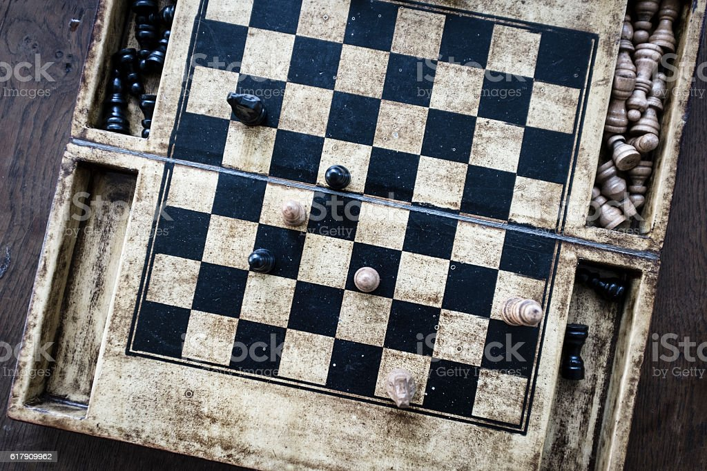 Chess game with wooden chess pieces stock photo