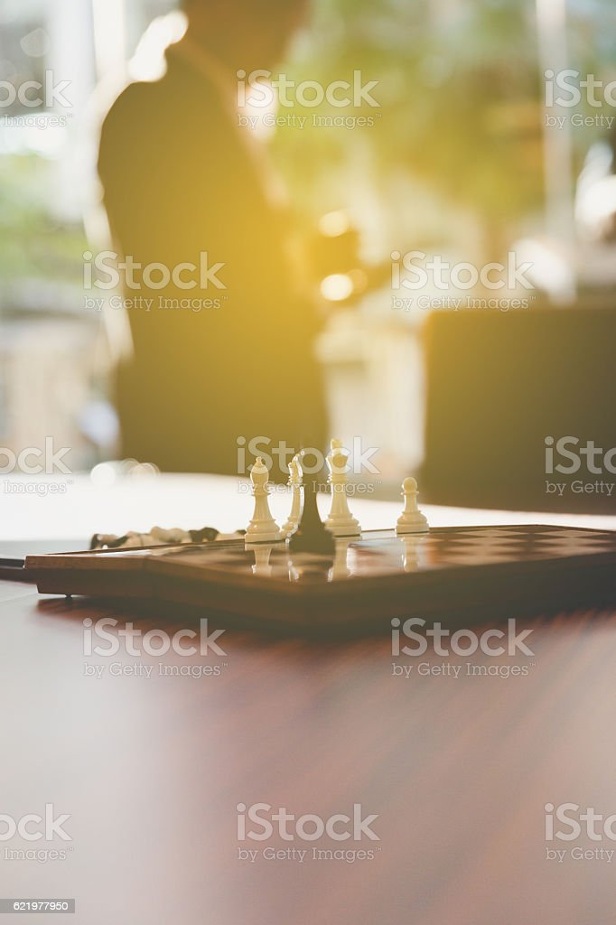chess in office with background of businessman stock photo
