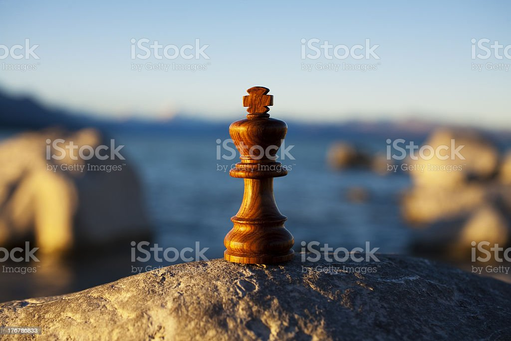 Chess King Outdoors with Blue Water and Rocks stock photo