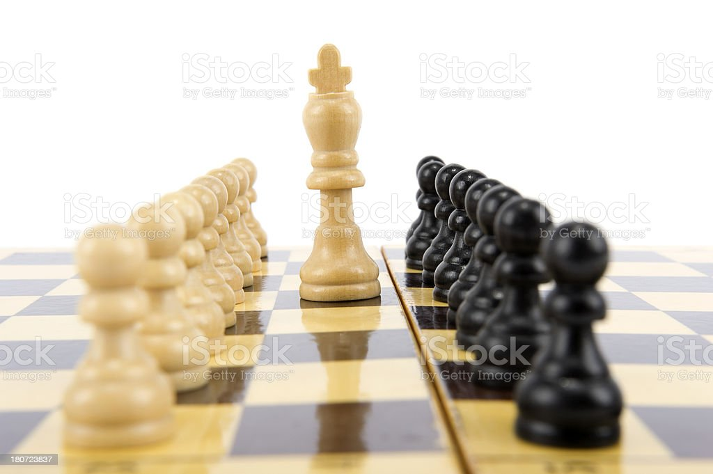 Chess King Standing In Front Of Pawns royalty-free stock photo