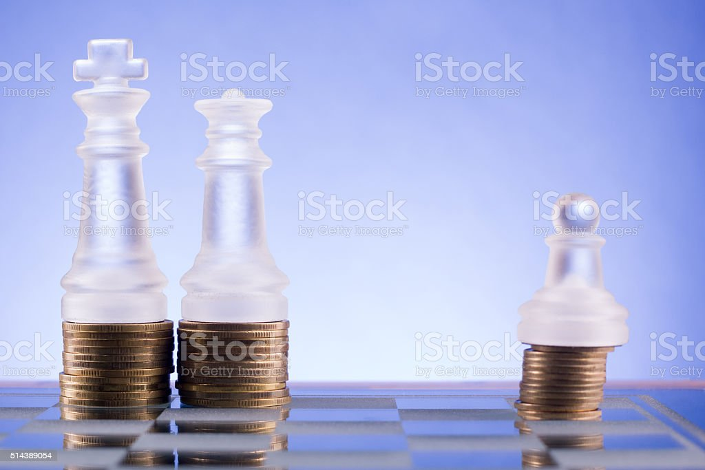 Chess on a golden coins. Investment strategy. Finance concept stock photo
