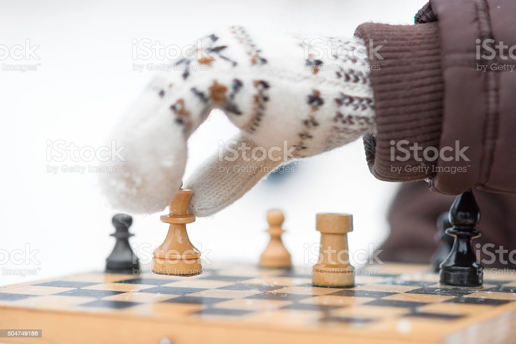 Chess on the snow background stock photo
