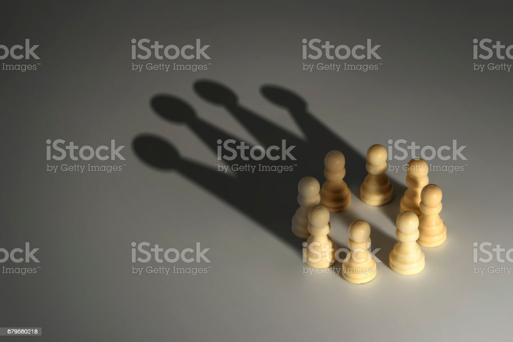 chess pawn circle with shadow shaped as a crown stock photo