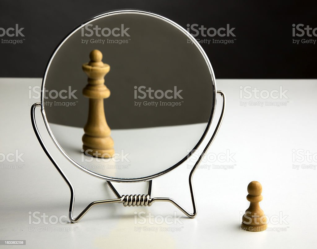 Chess Pawn Imagining Itself as a Queen. stock photo