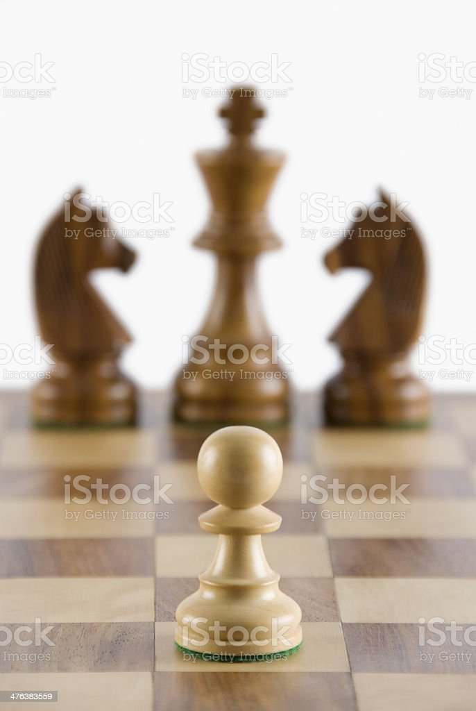 chess pawn on a chessboard royalty-free stock photo