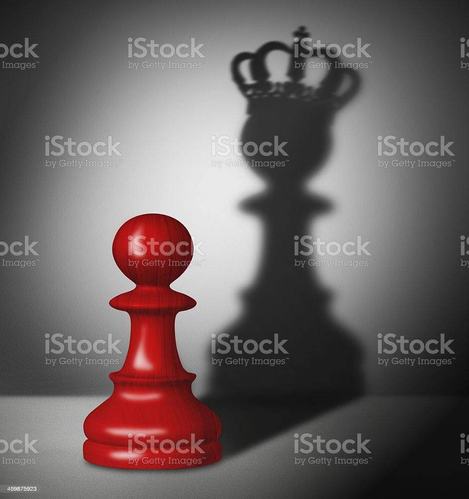 Chess pawn with the shadow of a king stock photo