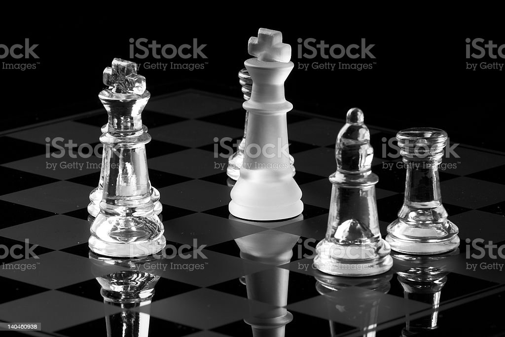 Chess pieces in hostile takeover stock photo