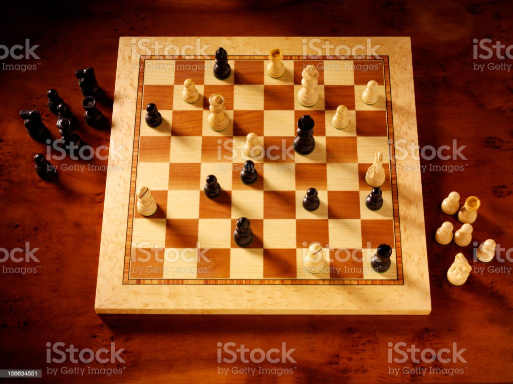 Chess Pieces on a Board royalty-free stock photo