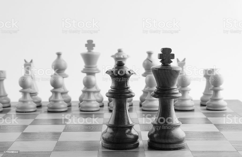 Chess pieces on a chess board royalty-free stock photo