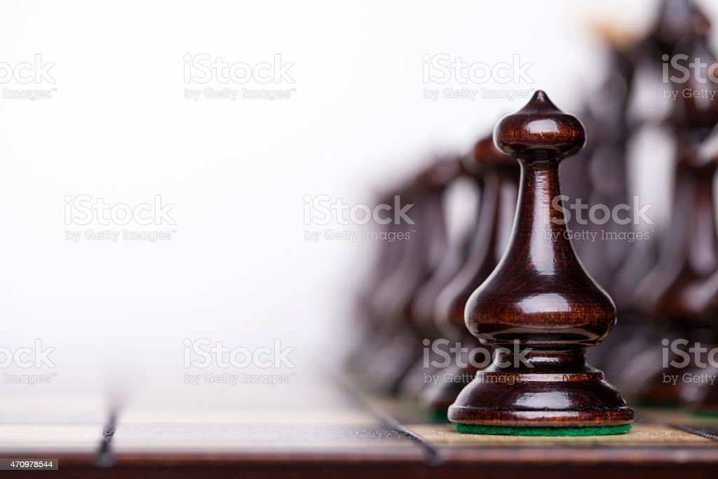 Chess pieces on a chessboard. stock photo