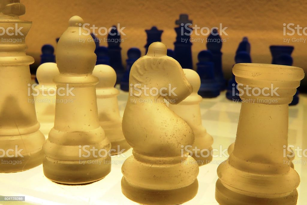 Chess pieces on board stock photo
