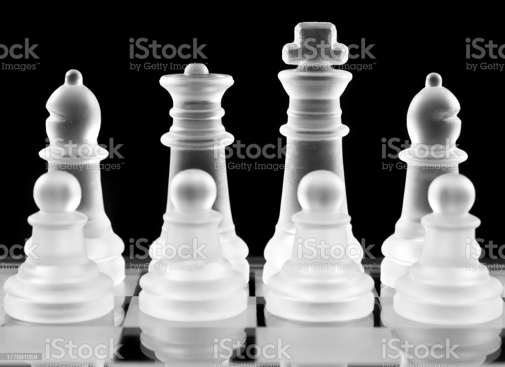 Chess pieces over black royalty-free stock photo
