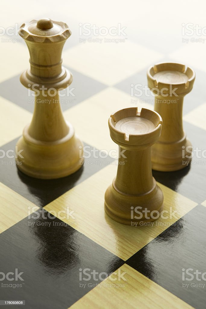 Chess: Queen and Rooks on Board stock photo