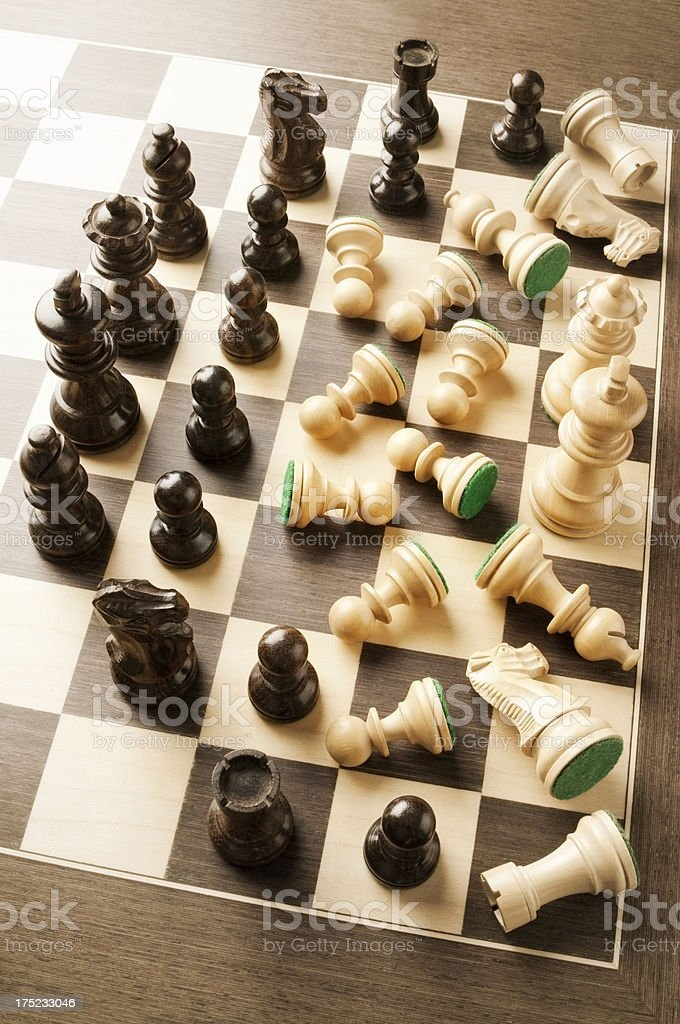 Chess team lyes defeated and surrounded by opposing team royalty-free stock photo
