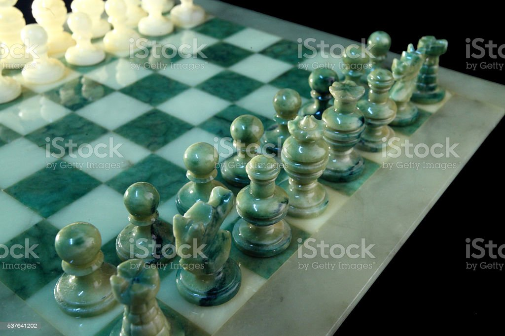 chessboard and alabaster chess k stock photo