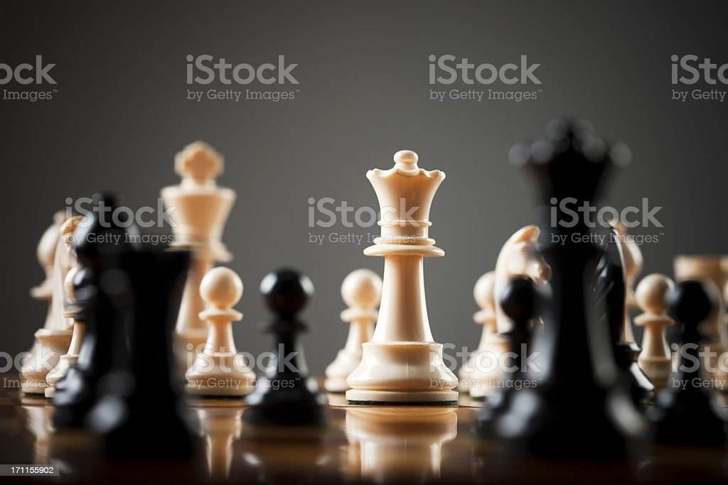 Chessboard level view of game, the white queen menacingly central stock photo