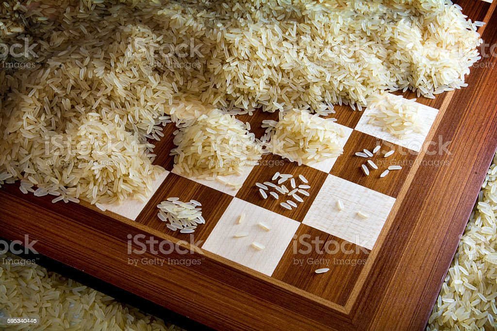 chessboard with expotential growing heaps of rice grains, legend stock photo