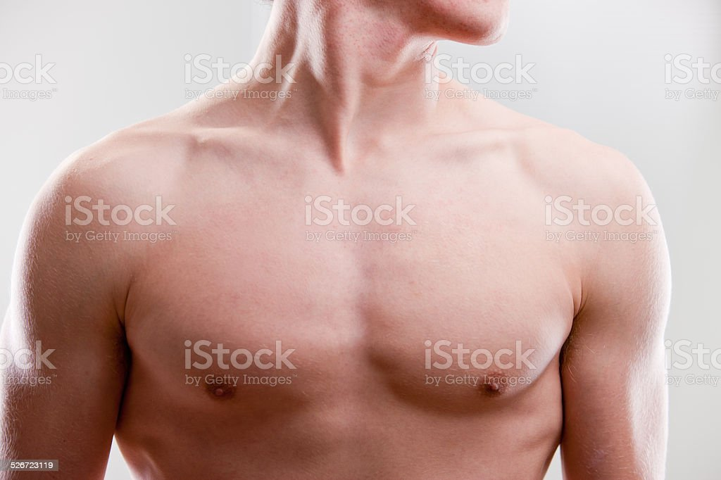 chest and neck of a young strong man stock photo